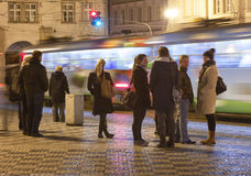 People on the bus-station on Evening Stock Image