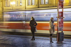 People on the bus-station on Evening Royalty Free Stock Photos