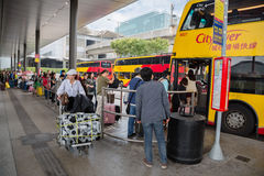 People at the bus stop airport, Hong Kong Stock Photos