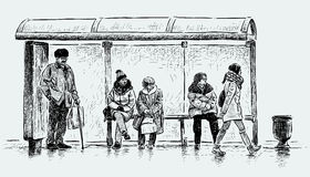 People on a bus stop Stock Photo