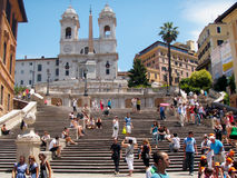 People busily moving along the Spanish Steps in Rome, Italy Royalty Free Stock Images