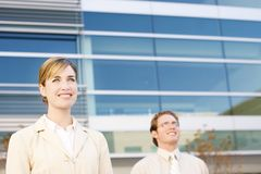 People in business. Business man and woman standing together Stock Image