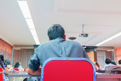People business education seminar training conference in interior meeting room. point of view back.  stock photography