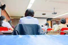 People business education seminar training conference in interior meeting room. point of view back.  royalty free stock image