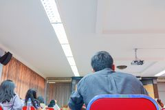 People business education seminar training conference in interior meeting room. point of view back.  stock photo