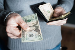 People, business, finances and money concept - close up of businessman hands holding open holding wallet and credit card Stock Image