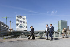 People in business outfit walk over railway utrecht via footbrid Royalty Free Stock Images