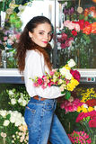 People, business, sale and floristry concept - happy smiling florist Royalty Free Stock Photo