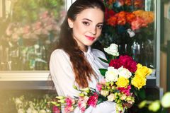 People, business, sale and floristry concept - happy smiling florist Stock Images