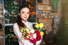 People, business, sale and floristry concept - happy smiling florist Royalty Free Stock Photos
