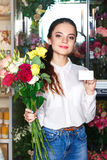People, business, sale and floristry concept - happy smiling florist Stock Photo