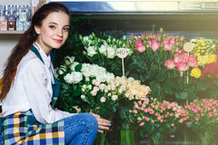 People, business, sale and floristry concept - happy smiling florist Royalty Free Stock Image
