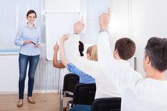 People in business training. Doubtful Candidates Raising Their Hands To Ask Questions Royalty Free Stock Photography