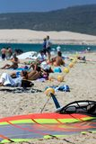 People on busy active kitesurfing beach in Spain Royalty Free Stock Photo