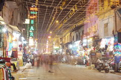 People are busy with daily activities on famous Main Bazaar Road Royalty Free Stock Photos