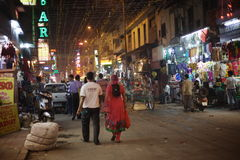 People are busy with daily activities on famous Main Bazaar Road Stock Photo