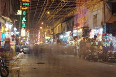 People are busy with daily activities on famous Main Bazaar Road Stock Images