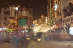 People are busy with daily activities on famous Main Bazaar Road Royalty Free Stock Photo