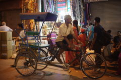 People are busy with daily activities on famous Main Bazaar Road Stock Photography