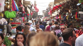 People in a busy market stock footage