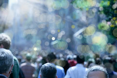 People on busy street. Blurry background image of people walking on busy street royalty free stock image