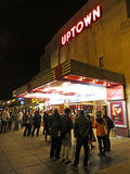 People at the Busy Uptown Movie Theatre stock image