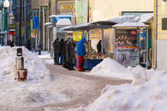 People buy cheap books in Arbat street. Arbat street of Moscow in wintertime. People buy cheap books in the street. Selling books in Moscow. Everyday life of Royalty Free Stock Photo