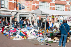 People buy clothes in a sale on daily Flea market, Waterlooplein. Stock Photo