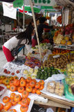 People buy fruits from the street in Macau Royalty Free Stock Photos