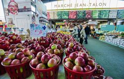 People buy groceries at Jean-Talon Market. The largest outdoor public market in North America. Circa April 2013, in Montreal Stock Photo