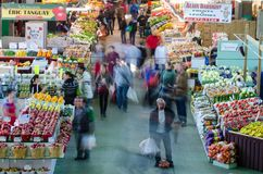 People buy groceries at Jean-Talon Market. The largest outdoor public market in North America. Circa April 2013, in Montreal Royalty Free Stock Photography