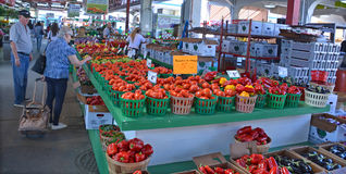 People buy groceries at Jean-Talon Market. MONTREAL QUEBEC CANADA 09 16 2016: People buy groceries at Jean-Talon Market is a farmer's market in Montreal. Located Stock Photography