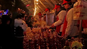 People buy local snacks at Wangfujing Snack Avenue during Chinese Spring Festival in Beijing, China stock video footage