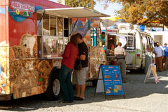 People Buy Meals And Snacks At Food Truck Park stock photography