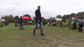 People buy plants and organic food sold in botanical festival stock video footage