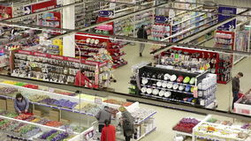 People buy products in large supermarket. Top view