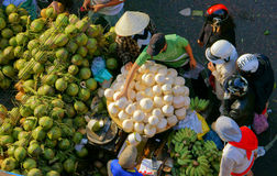 People buy and sell coconut at market.DA LAT, VIET NAM- FEBRUARY 8, 2013 Royalty Free Stock Photography