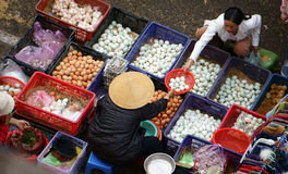 People buy and sell egg at market.DA LAT, VIET NAM- FEBRUARY 8, 2013 Royalty Free Stock Image