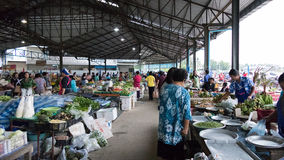 People buy and sell food in the local market Royalty Free Stock Photos