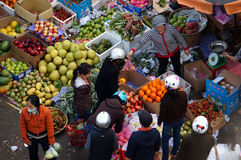 People buy and sell fruit at market. DA LAT, VIET NAM- FEBRUARY 8, 2013 Royalty Free Stock Photography