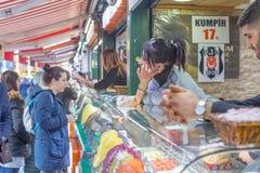 People buy waffle at waffle shops at Ortakoy royalty free stock photos