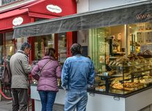 People buying baguette at downtown Paris stock photos