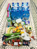 People Buying Basic Supermarket Products In Shopping Cart Trolley Stock Photo