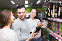 People buying beverages. Positive people buying beverages for dinner at food grocery Stock Images