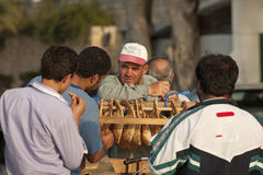 People buying bread, Lebanon. Men buying bread from a vendor, Lebanon Royalty Free Stock Image