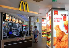 People buying chicken wings. Inside a local McDonald's Royalty Free Stock Photos