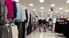 People buying clothes inside Walmart store stock video footage