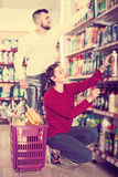 People buying detergents for house. Glad people buying detergents for house in the shopping mall Royalty Free Stock Image