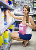 People buying detergents  in the shopping mall. Happy american people buying detergents for house in the shopping mall Stock Images