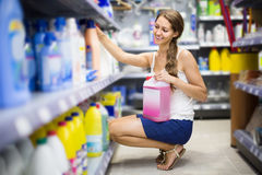 People buying detergents  in the shopping mall. Happy people buying detergents for house in the shopping mall Royalty Free Stock Images